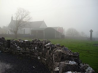 """Kilfenora - St. Fachtna's Catholic church and the """"West Cross"""" in the mist"""