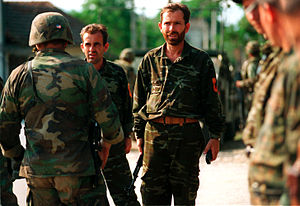 Kosovo Albanians - Kosovo Liberation Army handing over arms to U.S. forces, 30 June 1999.