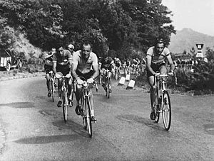 Fausto Coppi - Coppi (right) riding the 1953 Giro d'Italia