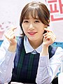 Laboum member with finger hearts in 2015.jpg