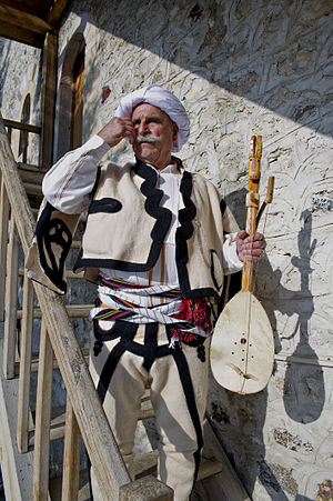 Traditional clothing of Kosovo - Traditional men's clothing of Podgur, characterized by marhama, as he carries the traditional instrument Lahuta