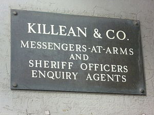 Messenger-at-arms - Legal firm's nameplate, Dundee, Scotland