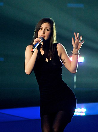 "Little black dress - Eurovision Song Contest winner, Lena, sporting a little black dress and black stockings while singing her winning song ""Satellite""."