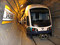 Link Light Rail train parked inside Downtown Seattle Transit Tunnel (8754014715).jpg