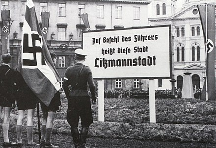 "Photo from Nazi-occupied Lodz just after its renaming as ""Litzmannstadt"" (1940). A board announcing a new name for a city. Litzmannstadt.jpg"