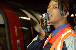 London Underground Employee making a Long Line Public Address system   announcement using an RPA01 Radio Microphone at Bank Station