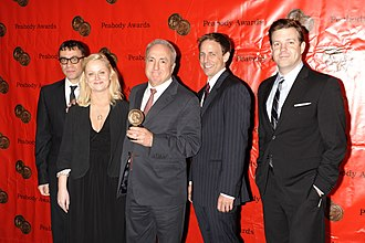 Amy Poehler - Poehler with SNL co-stars and creator Lorne Michaels in 2008.