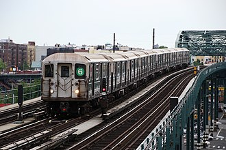 6 (New York City Subway service) - Pelham Bay Park-bound 6 express train  of R62A cars passing Elder Avenue