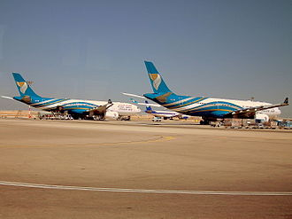 Muscat International Airport - Oman Air Airbus A330-300s parked on the apron of the old terminal. Until the opening of the new Terminal 1, there were no jetbridges available.