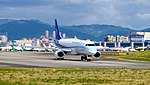 Mandarin Airlines Embraer 190 B-16822 Departing from Taipei Songshan Airport 20160731a.jpg