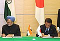Manmohan Singh and the Prime Minister of Japan, Mr. Taro Aso signing of the MoU for further strengthen the cooperation between the scientists and other concerned people in two countries, after the Indo-Japan Summit, in Tokyo.jpg