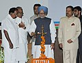 Manmohan Singh lighting the lamp at inauguration of the Indian Institute of Corporate Affairs Campus, at Manesar, Haryana. The Union Minister for Corporate Affairs, Dr. M. Veerappa Moily, the Chief Minister of Haryana.jpg