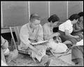 Manzanar Relocation Center, Manzanar, California. Evacuees of Japanese ancestry rest in the cool of . . . - NARA - 538071.tif