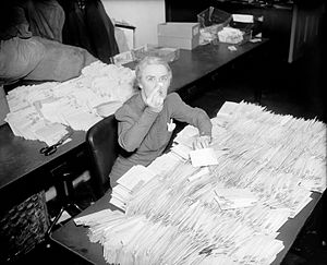 March of Dimes - FDR's personal secretary Missy LeHand with 30,000 letters containing ten-cent contributions to the National Foundation for Infantile Paralysis that arrived at the White House the morning of January 28, 1938
