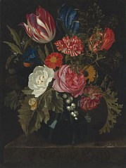 Flowers in a vase on a marble ledge