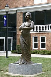 This eight foot bronze sculpture was erected on November 9, 2006 in front of Twichell Auditorium on the campus of Converse College in Spartanburg, South Carolina. Designed by New York-based artist Meredith Bergmann and commissioned by the college; the sculpture is housed permanently on the campus.