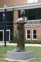 This eight foot bronze sculpture was erected on 09/11/2006 in front of Twichell Auditorium on the campus of Converse College in Spartanburg, South Carolina. Designed by NY-based artist Meredith Bergmann and commissioned by the college; the sculpture is housed permanently on the campus.