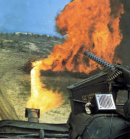 "View from the turret of an M67 ""Zippo"". On the right is a mounted M1919 Browning machine gun with an attached box of linked .30-06 ammunition. Marineflametank1968.jpg"