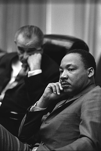 Civil Rights leader Martin Luther King Jr. (right), with President Lyndon B. Johnson in the background (left) Martin Luther King, Jr. and Lyndon Johnson.jpg