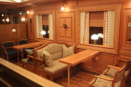 Wood-paneled dining car, with comfortable seating