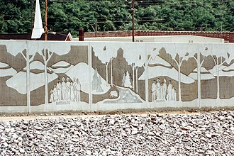 Hatfield–McCoy feud - A section of the flood wall along the Tug Fork in Matewan, West Virginia, constructed by the U.S. Army Corps of Engineers, depicts the Hatfield–McCoy feud.