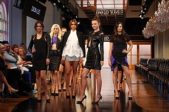 Model (person) - Models led by supermodel Miranda Kerr do the final runway walk at a fashion show
