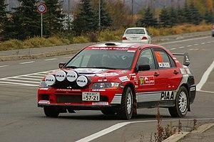 Katsuhiko Taguchi - Taguchi in his Mitsubishi Lancer Evo IX on the 2007 Rally Japan, where he finished eighth.