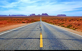 Western United States - The West, as the most recent part of the United States, is often known for broad highways and freeways and open space. Pictured is a road in Utah to Monument Valley.