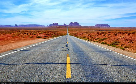 The West, as the most recent part of the United States, is often known for broad highways and freeways and open space. Pictured is a road in Utah to Monument Valley. Monument Valley road.jpg