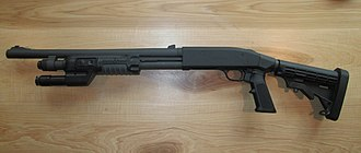 "Mossberg 500 - Mossberg 590A1 Tactical, 12 Ga, 6-shot, 18.5"" barrel, tactical light, and collapsible stock"