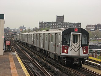6 (New York City Subway service) - A train made of R142A cars in ⟨6⟩ (express) service passing St. Lawrence Avenue, bound for Pelham Bay Park