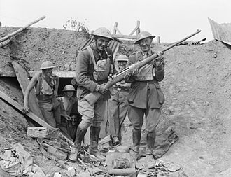 Anti-materiel rifle - New Zealand Officers of the British Expeditionary Force with a captured German anti-tank gun in Second Battle of Bapaume, France, during World War I. This photograph is evidence of how quickly military technology had to evolve during World War I.
