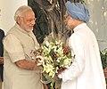 Narendra Modi meets Dr. Manmohan Singh.jpg