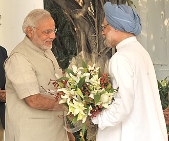 Prime Minister of India - Prime Minister Narendra Modi (left) meets his predecessor, Manmohan Singh (right), c. 2014.