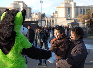 A fursuit interacting with a child