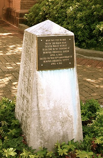 """Memphis Zoo - A marker where """"Natch"""" the bear was chained in 1906. The old elephant building behind it is now the zoo's education library."""