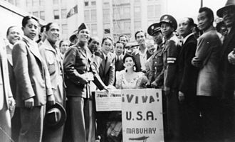 Nationality Act of 1940 - Filipino men celebrating their newly earned U.S. citizenship that was gained through the Nationality Act of 1940, due to their efforts of fighting for the U.S. in World War Two.