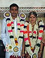 Newly married at Madurai Meenakshi temple.jpg