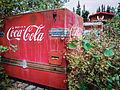 Old Coke machine at Moose Creek Lodge, Yukon (10752909673).jpg