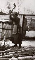 Olga Nikolaevna chops wood at Tobolsk.jpg