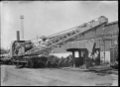 Overturned crane in process of being righted, at the Petone Railway Workshops, 1923 ATLIB 312395.png