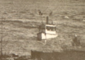 P10135 0001 - Argo anchored off Stony Island, Great Slave Lake (cropped).png