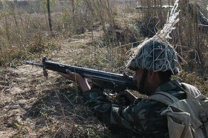 War in North-West Pakistan - A soldier of Pakistan army in combat position.