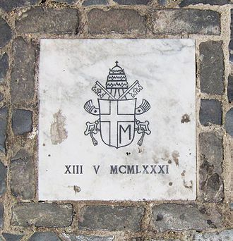 Pope John Paul II assassination attempt - The site of the shooting is marked by a small marble tablet bearing John Paul's personal coat of arms and the date in Roman numerals.