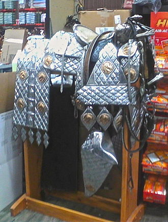 Western saddle - Parade saddle with extensive silver plating, tapaderos, and flank trappings