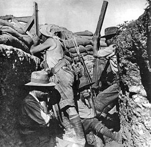 Third attack on Anzac Cove - Australian troops in their trench, observing the Turkish lines through periscopes, one fixed to a rifle