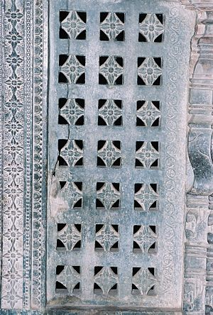 Lakkundi - A pierced window screen brings light into the mantapa at Manikesvara Temple in Lakkundi