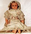 Pierotti wax doll from Frederic Aldis, London, 01, sitting doll, vested.jpg