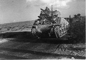 Tanks in the Israeli Army - Palmach M4 Sherman tank leading a convoy.