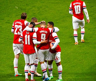 2014 FA Cup Final - Arsenal players celebrating Lukas Podolski's goal against Coventry City.